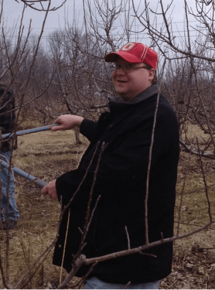 The Snarky Gardener learning to prune apple trees.