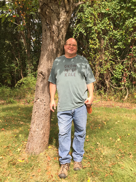 "The Snarky Gardener posing by his favorite (and only) crab apple tree. ""Does this tree make me look fat?"""