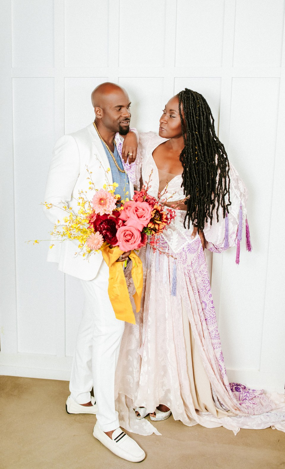 Black couple in love at their rainbow elopement ceremony in San Diego