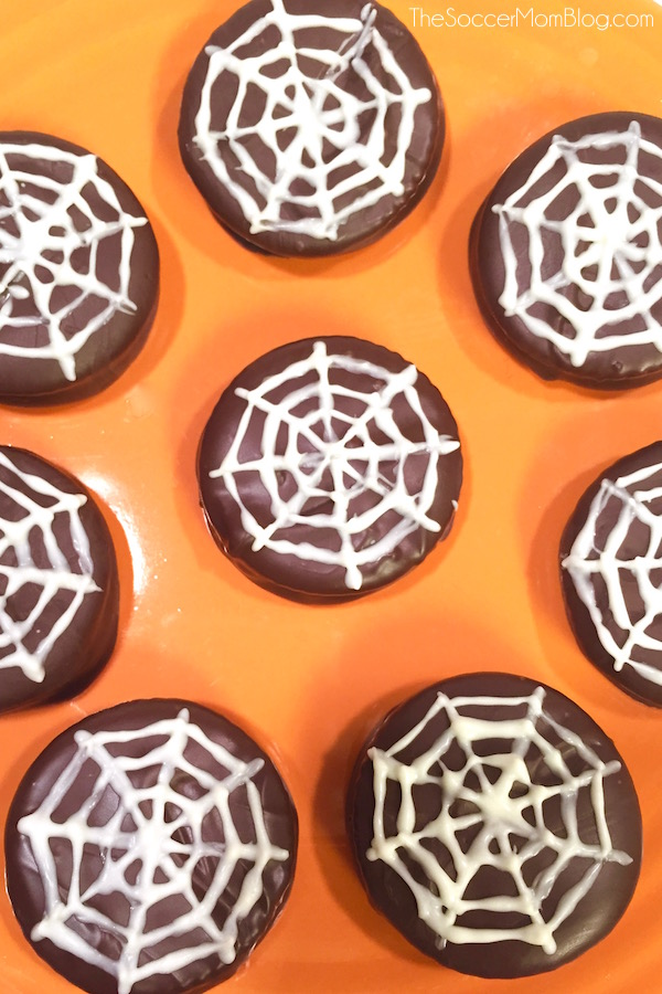 A holiday favorite with a Halloween twist: Chocolate Dipped Peanut Butter Crackers (aka Spiderweb Cookies) are incredibly easy & perfect to make with kids! Did I mention they combine two of my favorite things, chocolate and peanut butter?? #SpreadTheMagic [ad] - The Soccer Mom Blog