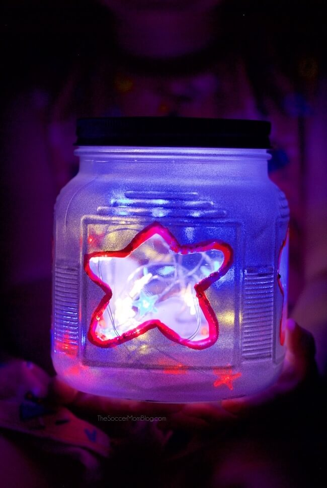Add a gorgeous glow to your Memorial Day or 4th of July celebrations with these fun and easy patriotic kid-made mason jar lanterns!