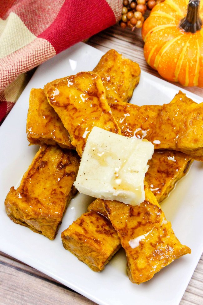 The ultimate Fall breakfast!! These delightful Pumpkin French Toast Sticks will totally make you feel all warm and fuzzy inside!