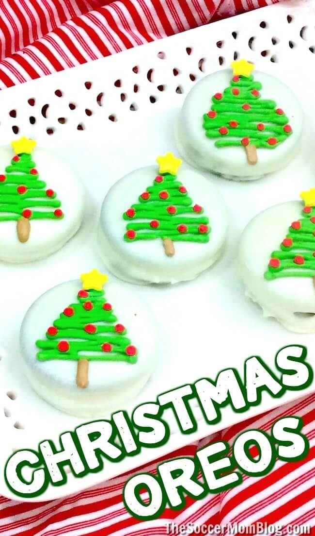 It doesn't get much cuter than this!! Easy chocolate covered Christmas Oreos make a party-perfect treat or holiday gift that kids can make!