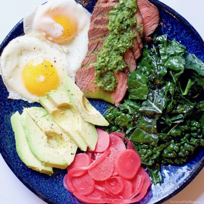 Chimichurri steak salad with fried egg, kale, avocado, pickled onions & radishes