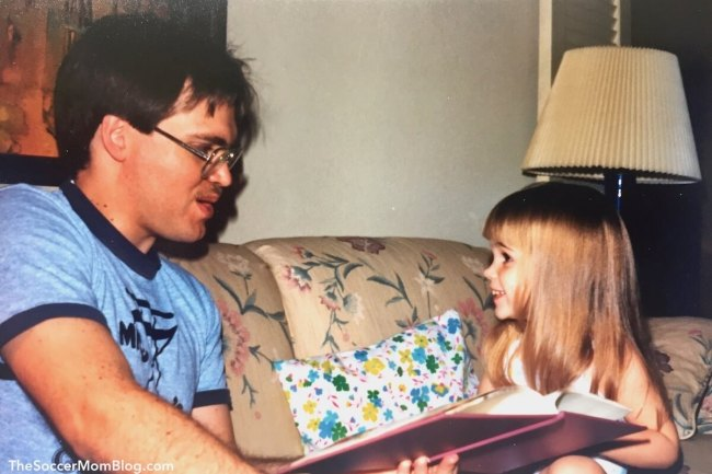 Dad reading to little girl (The Soccer Mom Blog)