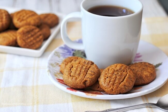 Low carb peanut butter cookies on plate with cup of coffee