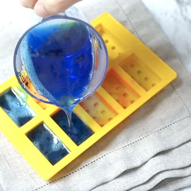 Pouring jello soap mixture into silicone mold