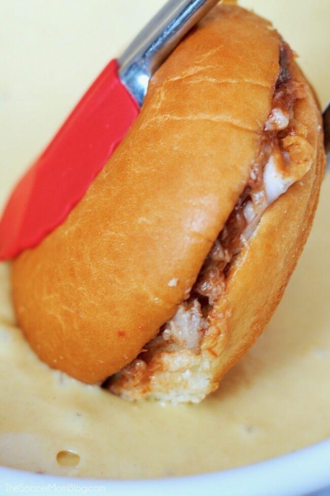 Dipping monte cristo sandwich into batter