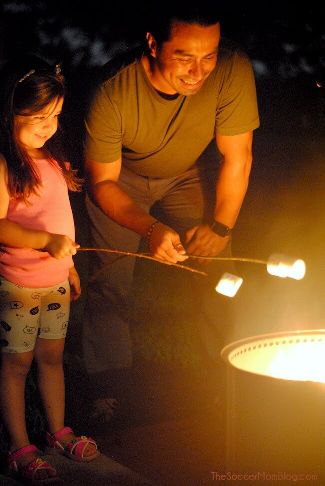 roasting marshmallows over the Solo Stove backyard fire pit