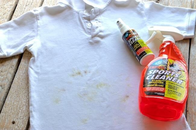 Grass stained white shirt and ESPRO sports cleaner bottles