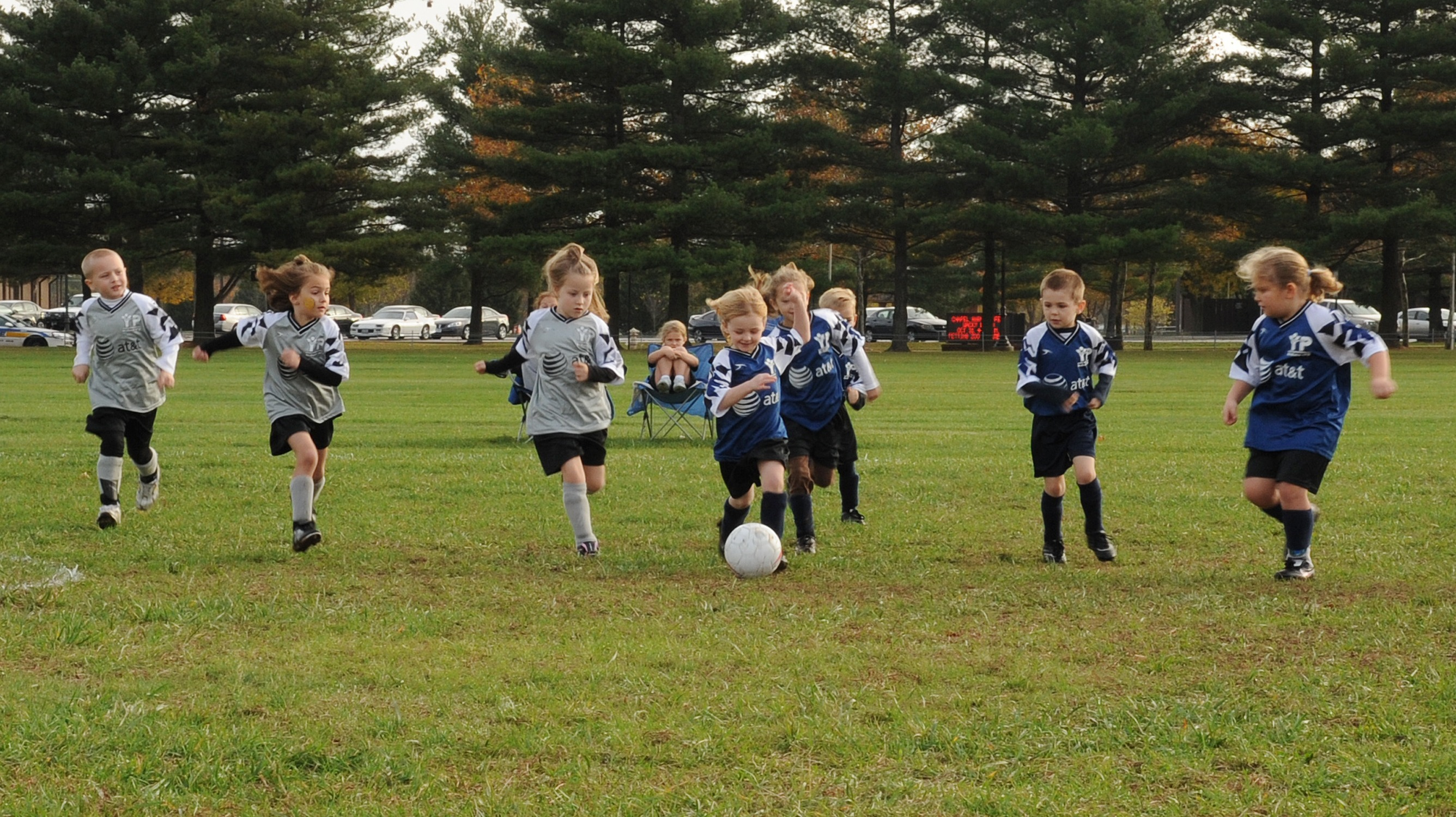 Soccer players show a finishing mentality as they plough through the mud and rain to compete in the final games of the Pee Wee League Saturday. Children interested in playing Youth Sports basketball can now register at the Youth Center.