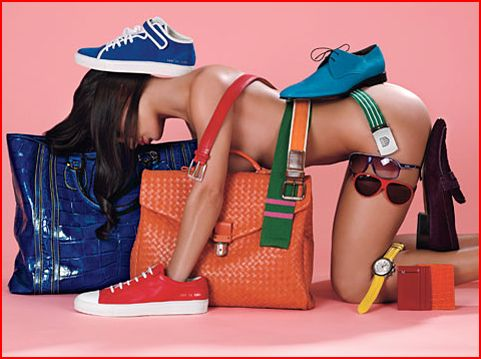 A woman's naked body used as a shelf for fashion accessories.