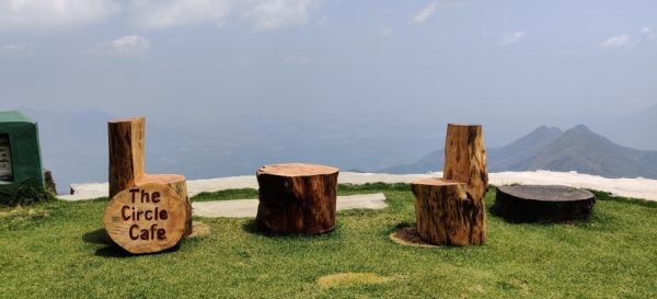 Wooden chairs oerlooking a valley