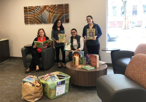 Naveo Credit Union Collects 250 Books To Benefit The Massachusetts