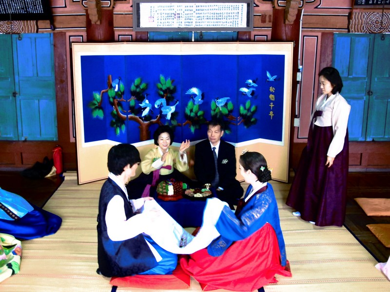 Korean Traditional Wedding Ceremony: Multicultural Couple, Family. Hanbok. Paebaek Ceremony