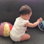 baby playing with balls