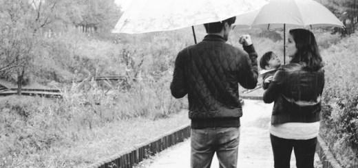 Family walking in the rain