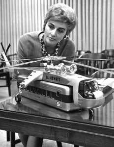A woman inspects a model of helicopter with passenger-carrying pod in photo published April 4, 1965, in the Los Angeles Times. Photo courtesy of Los Angeles Times photographic archive, UCLA Library.
