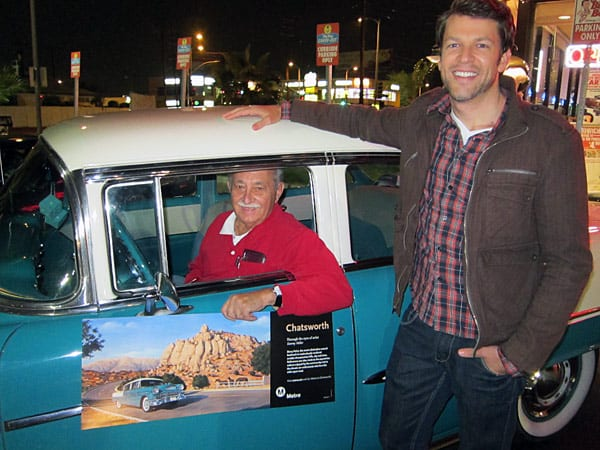 Artist Danny Heller, right, greets Joe DiFatta in his '55 Chevy Bel Air featured in Metro's 'Chatsworth' poster pictured here.