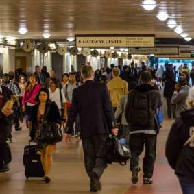 All those passengers add up to big crowds in the tunnel that serves the train platforms and connects the transit plaza to the front of the building.