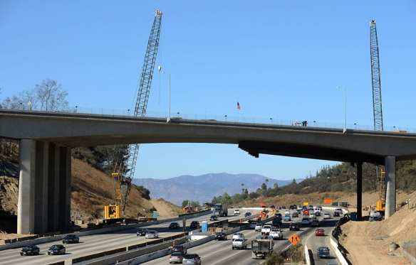 The new Mulholland Bridge is reaching completion.  Photo shows metal supports that have been removed from the Southbound 405. Saturday night they will be removed from the Northbound 405.