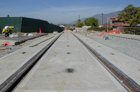 Tracks crossing First Street in downtown Arcadia next to the new station platform.