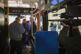 Metro Board Member Jackie Dupont-Walker inspecting the new bus.