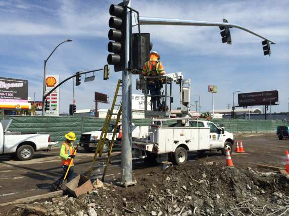 Installation of new traffic signals to replace the ones that had been mounted on the bridge.
