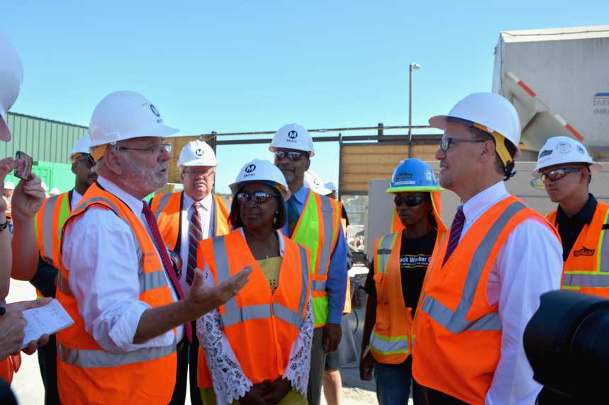 Metro CEO and U.S. Labor Secretary talk about the new light rail line now under construction as Metro Board Member Jackie Dupont-Walker witnesses. (Photo Luis Inzunza/Metro.)