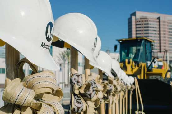 Fifteen hardhats and shovels awaiting the big ceremony. Photos by Metro.