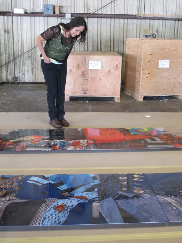 The artist with some of the completed artwork panels.