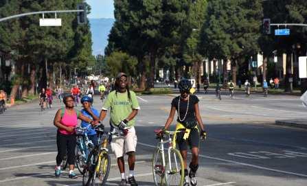 Cyclists approaching the Leimert Park Hub at CicLAvia South LA. (Photo: Joseph Lemon/Metro)