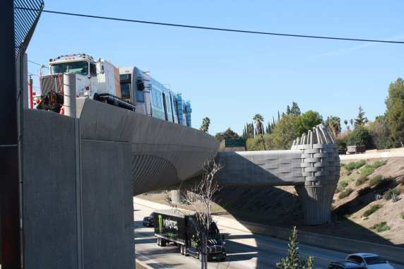The truck and test car on the Gold Line bridge over the eastbound lanes of the 210 freeway in Arcadia. Photo by Metro Gold Line Foothill Extension Construction Authority.