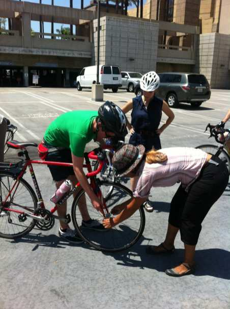 Instructor shows how to perform a bike check.