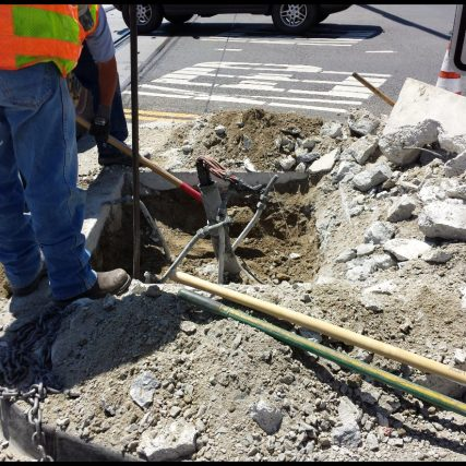Crews at work repairing the pole this afternoon. photo by Metro.