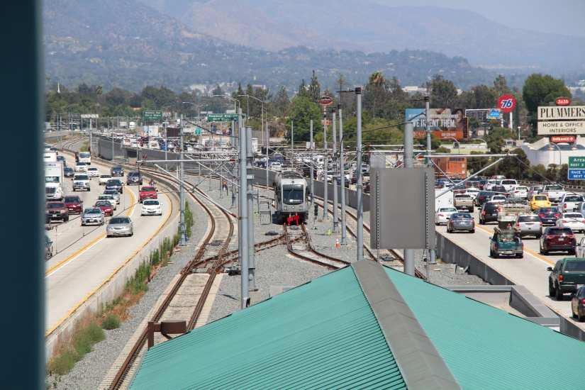 A Gold Line test train leaving the current terminus at Sierra Madre Villa and headed toward Arcadia in the median of the 210 freeway. Photo: Foothill Gold Line Construction Authority.