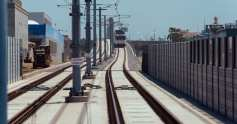 A test train heading east over Pico Boulevard and the undercrossing of the 405.