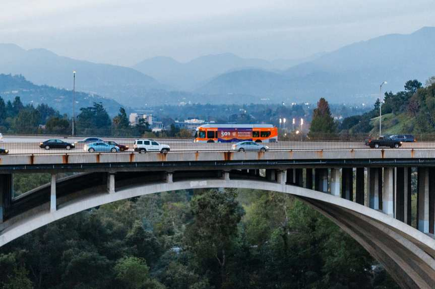 The new NoHo-Pasadena Express crossing the Arroyo Seco in Pasadena on Thursday. Click above for more info on the new express bus. Photo by Steve Hymon/Metro.