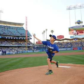 Sean Lukes throwing the first pitch. Photo: Juan Ocampo/Dodgers
