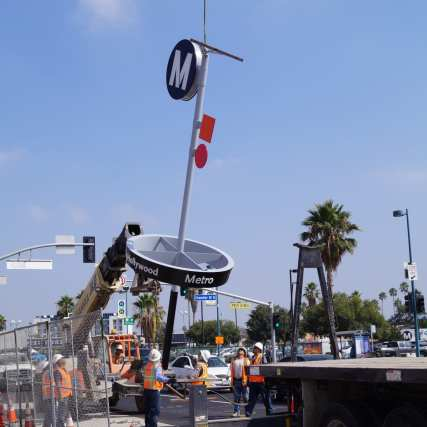 Metro Pin delivered by fabricator and being hoisted by crane at the project work site.