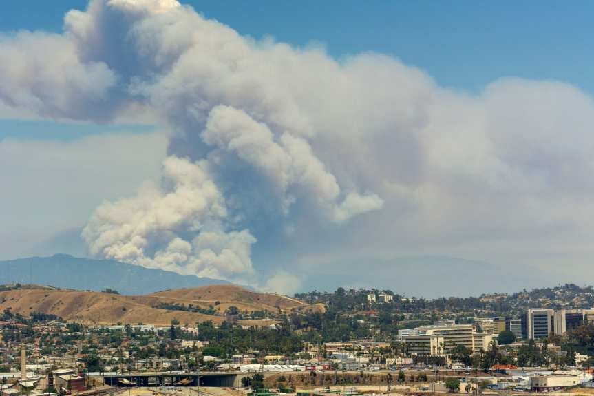 Wildfires in Duarte and Azusa burn last summer as seen from my office in the Metro building. Photo by Steve Hymon.