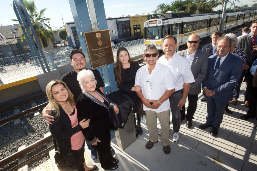 Members of Joe Gandara's family and Santa Monica officials at 26th St/Bergamot Station on Friday. Photo by Gary Leonard for Metro.