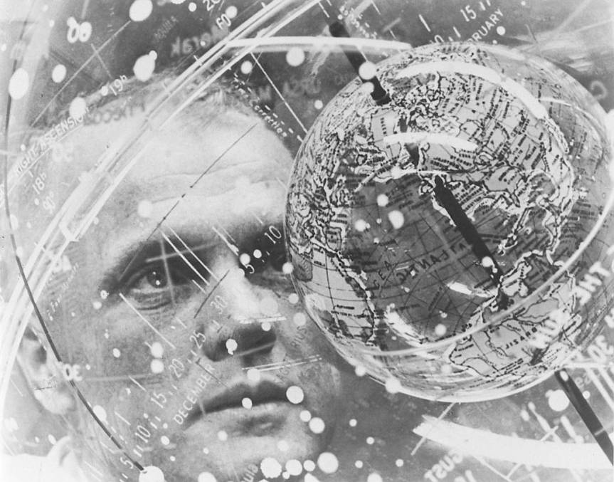 "n February 1962, Astronaut John H. Glenn Jr. looks into a globe, technically the ""Celestial Training Device"" at the Aeromedical Laboratory at Cape Canaveral, Florida. Glenn became the first American to orbit Earth that same month. Image Credit: NASA"
