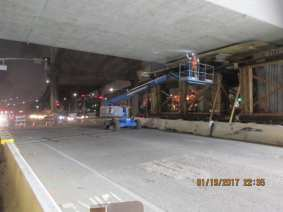 Removal of falsework on the Green Line underpass.