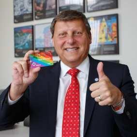 Metro Board Member Ara Narjarian grabs a Pride TAP card.