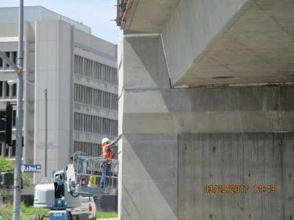 Surface finishing of the bridge structure over La Brea Avenue.
