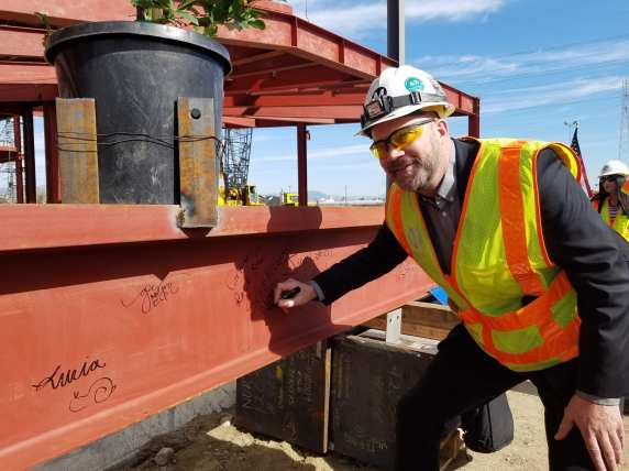 Scott McConnell, the Purple Line Extension Transit Project, Section 1 Deputy Executive Officer, signing the nearly 20-ton 'top off' beam.
