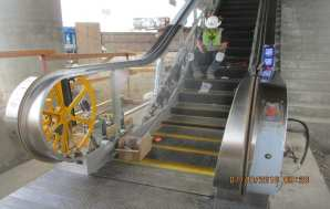 Installation of escalators at the Aviation/Century Station pavilion.