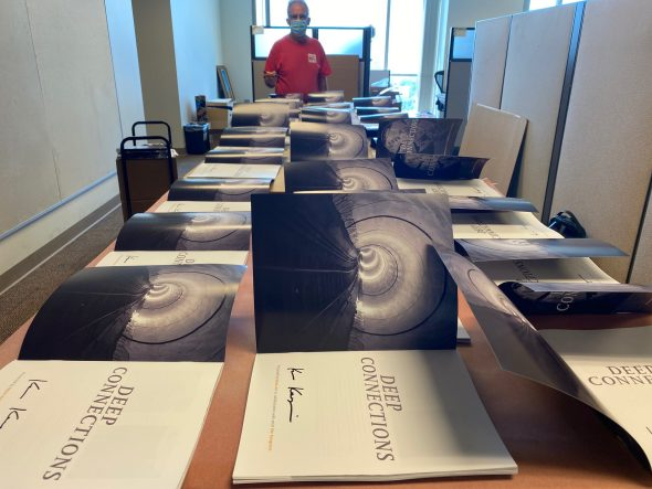 The artist signs a limited selection of catalogs at Metro Headquarters.