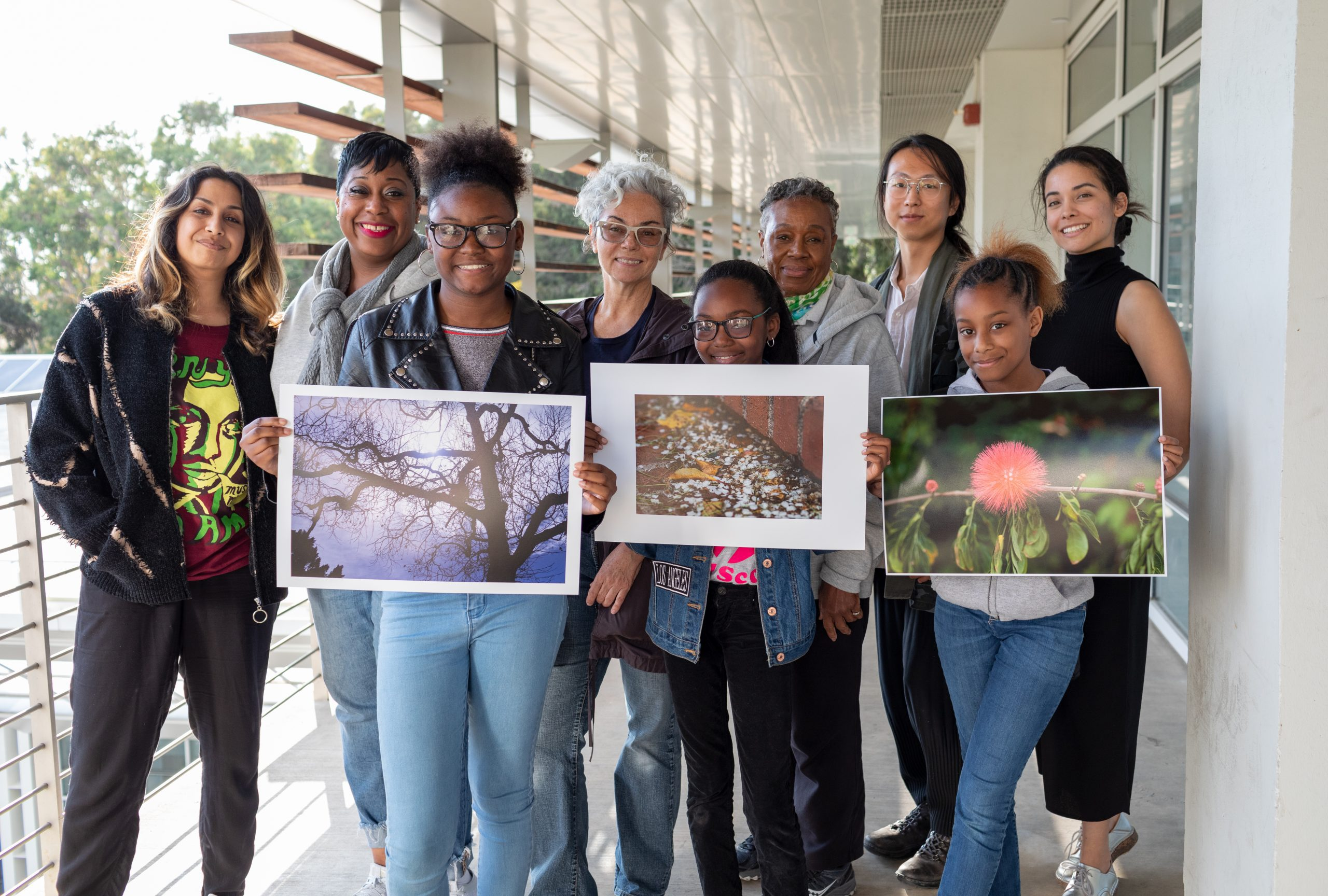 Rebeca Mendez, the West Angeles Church Girl Scout Troop and prints of their photographs